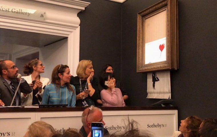 Berühmtes Banksy-Kunstwerk zerstört sich nach Millionen-Gebot selbst